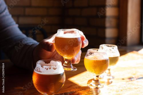 Photo  Man tasting beer samples at local brewery