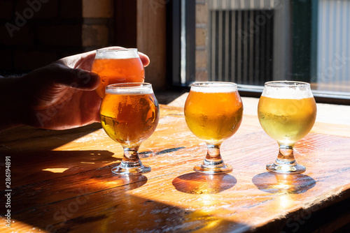 Платно Tasting beer samples from a flight