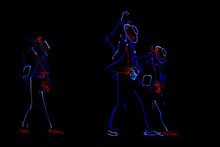Dancers In Suits With LED Lamps.
