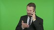 Frustrated Young Businessman get angry on Call against Chroma Key