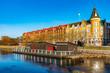 canvas print picture - Residential buildings alongside river Gavlean in Gavle, Sweden