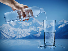 Hand Pouring Mineral Water Fro...
