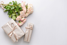 Gift Boxes And Beautiful Flowers On Light Background