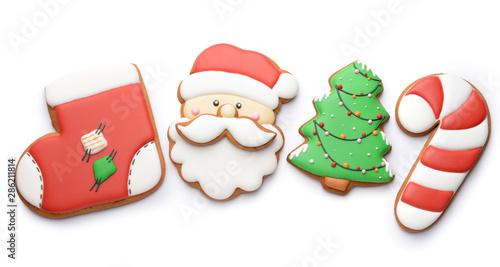 Obraz na plátně  Tasty Christmas cookies on white background