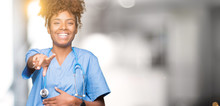 Young African American Doctor Woman Over Isolated Background Laughing Of You, Pointing To The Camera With Finger Hand Over Chest, Shame Expression