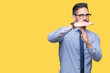 Leinwandbild Motiv Young business man wearing glasses over isolated background Doing time out gesture with hands, frustrated and serious face