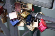 Colorful Group Of Padlocks Attached To A Bridge Close Up