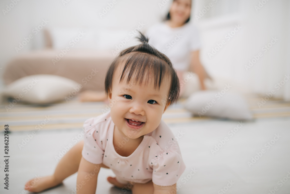 Fototapeta portrait of asian mother and baby relaxing in the room