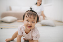 Portrait Of Asian Mother And Baby Relaxing In The Room
