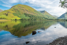 Hikking Between Brotherswater And Angle Tarn Near Patterdale In The English Lake Districr Surrounded By Many Wainwrights