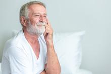 Senior Man Sitting In Bed, Thi...