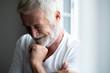 canvas print picture - Happy senior man portrait. Bearded man. Small laugh.