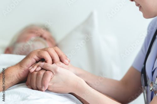 Papel de parede  Senior man in bed with nurse in retirement home