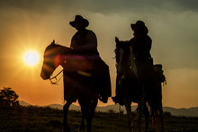 Silhouette Of Cowboys On Horse...