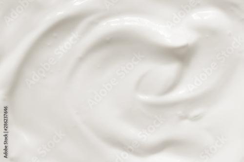 Photo  Cream, yogurt texture. White dairy food background.