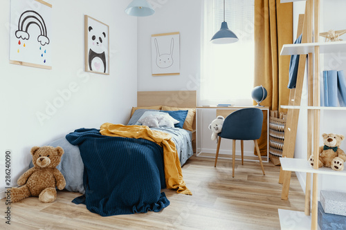 Fotomural  Workspace with desk and chair in elegant teenager's room with blue and orange de