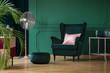 Velvet pouf and chair in bottle green interior