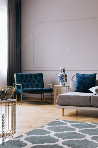 Fashionable armchair in trendy living room interior in contemporary apartment