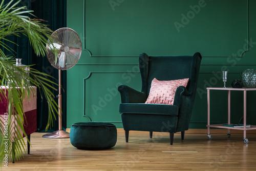 Obraz na plátně  Velvet pouf and chair in bottle green interior