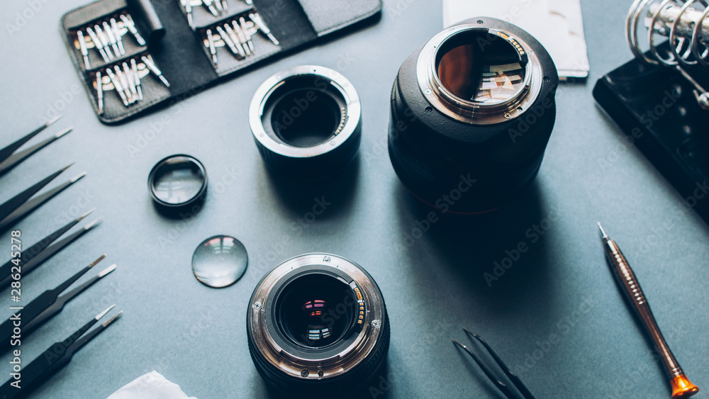 Fototapety, obrazy: Electronic device service. Photo camera optical dslr lens and repair tool set.