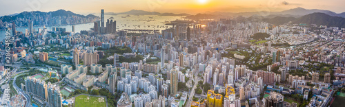 Photo  Sunset of Victoria Harbor, cityscape of Hong Kong