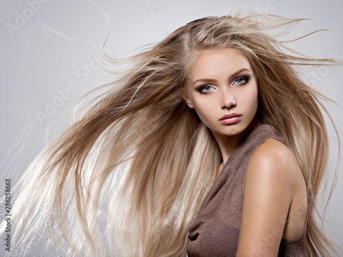 Obraz na plátně  Beautiful young woman with long straight white hair