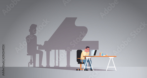 Fotografie, Obraz overworked man sitting at workplace using laptop shadow of man playing piano ima