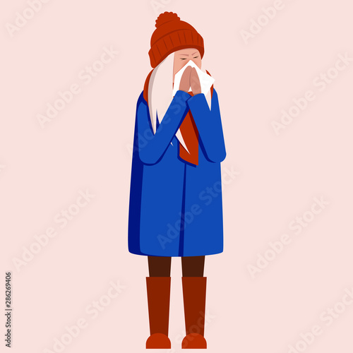 Girl has runny nose and viruses around on a blue background Fototapete