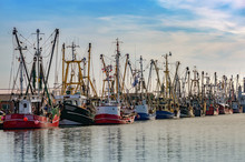 Fishing Boats In The Harbor Of...