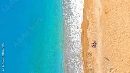 Cadres-photo bureau Bleu jean Beach aerial. People relaxing on a tropical beach near the water. Top view.