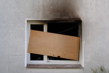 Barricaded Window After The Fire Damage In An Apartment House, Concept For Arson, Negligence And Insurance