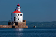 Wisconsin Point Lighthouse On Lake Superior With Fishing Boat