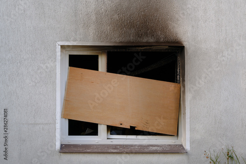 Barricaded window after the fire damage in an apartment house, concept for arson Canvas Print