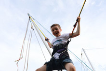 Happy Child Jumping On Bungee ...