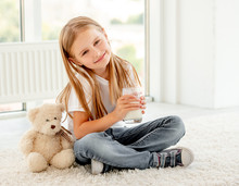 Cute Child Girl Cuddling With Teddy Bear