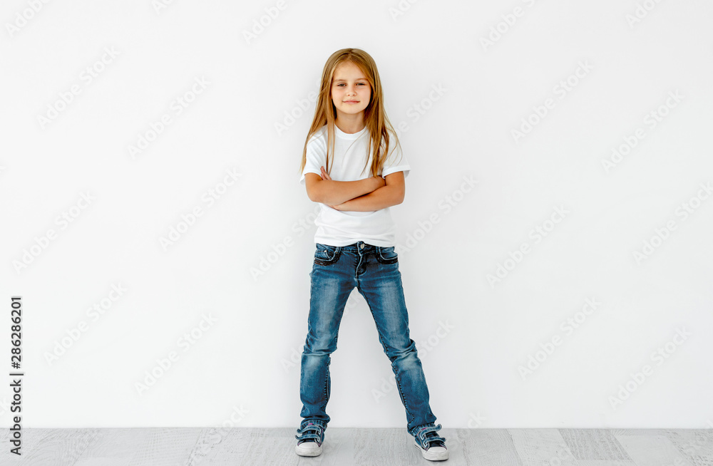 Fototapeta Cute little girl with crossed hands isolated on white