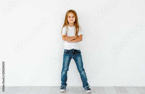 Cute little girl with crossed hands isolated on white