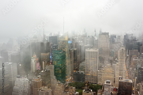 Staande foto New York Top view of New York skyline in rainy and cloudy day. Skyscrapers of NYC in the fog.