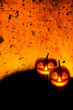 canvas print picture - Halloween background wallpaper with jack o lantern scary pumpkins on grunge textured orange backdrop.