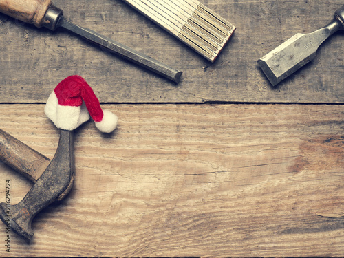 Fotomural  Carpenter tools with the hat of Santa
