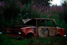 Old Battered Wrecked Car In Th...