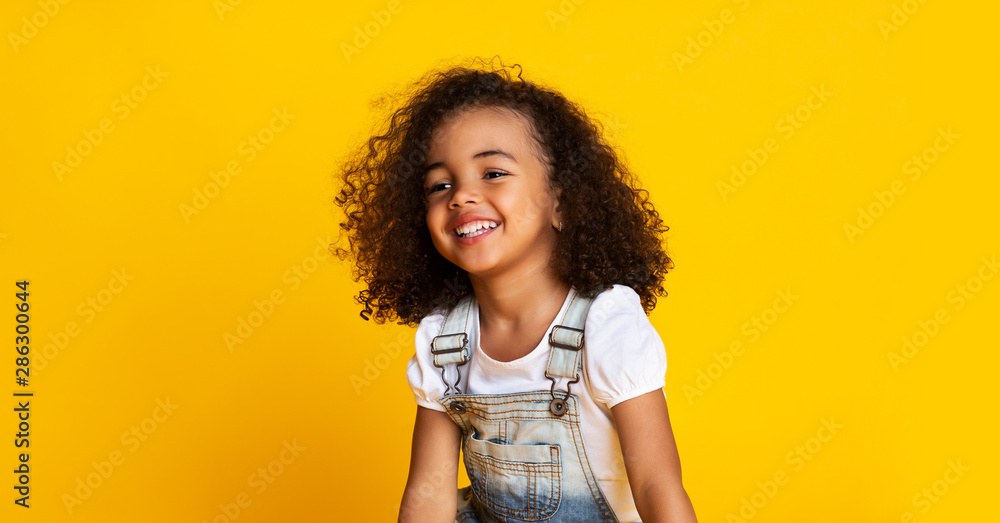 Fototapety, obrazy: Laughing cute afro girl portrait, yellow background