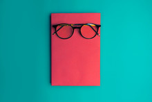 Glasses, Book And Stationery Placed On Blue Background, Back To School Concept, Copy-space