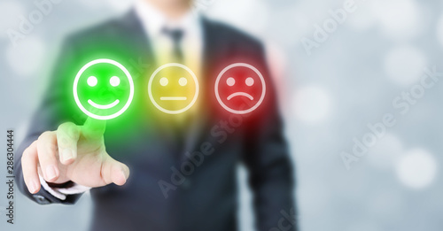 Foto Businessmen choose to rating score happy icons