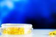 Leinwanddruck Bild - Omega 3 fish oil yellow soft gel capsules.