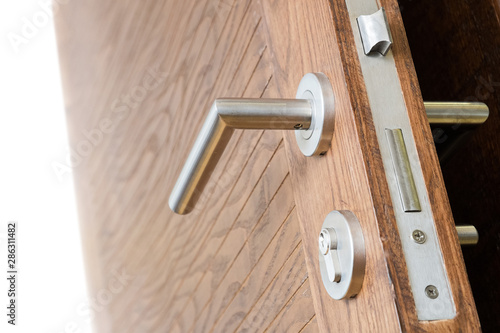 Obraz Modern, contemporary satin handle and keyhole detail - fototapety do salonu