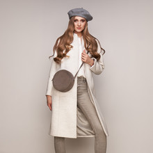 Young Elegant Woman In Trendy White Coat. Blond Hair, Gray Beret, Isolated Studio Shot. Fashion Autumn Lookbook. Model Woman With Handbag