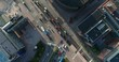 Aerial top down view of junction with cars and traffic at the morning rush hour during summer sunny day. Drone flying above filming straight down and indirect following the street. Helsinki Finland