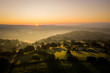 aerial view of sunrise over a welsh rural countryside landscape with morning mist