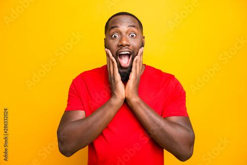 Photo of excited ecstatic rejoicing overjoyed black man admiring something adori Wallpaper Mural